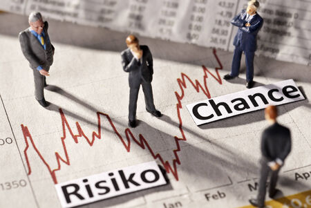 finanzen: Businessmen skeptical look at the history of a stock price.