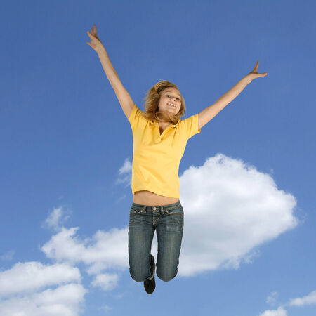 boundless: Blond teenager jumping in front of a blue sky
