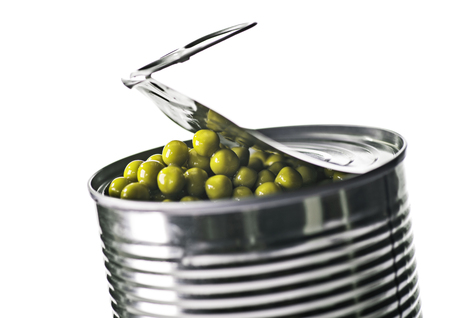 Partly open tin can with green peas.