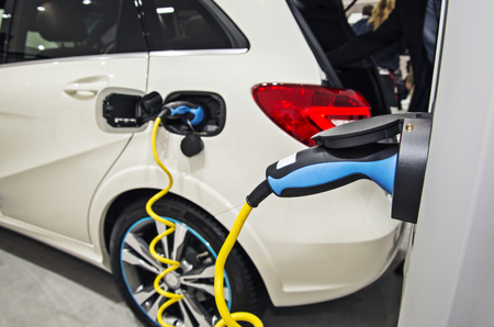 Electric car at the charging station Imagens