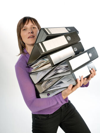 dragging: Business woman carrying a stack of file folders