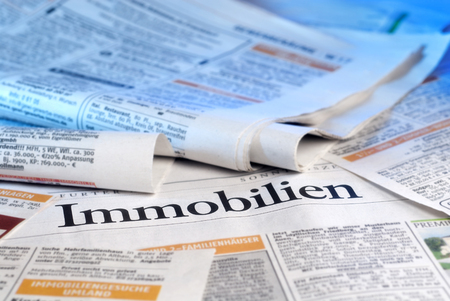 immobilien: Newspapers with various real estate offers and the writing  Immobilien