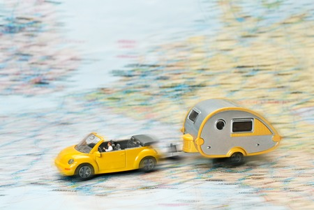 Car with caravan moves on Map of Europe  Standard-Bild