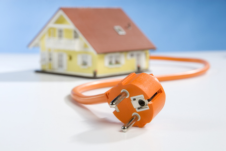 mains: House, power cable and plug Stock Photo