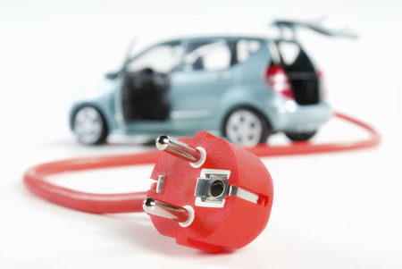 carbon neutral: Car with red power cord and plug