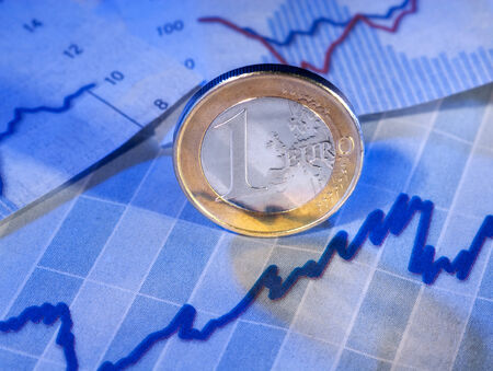 monetary policy: Euro Coin and graph Stock Photo