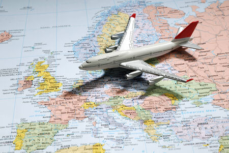 Model of a passenger aircraft on a map of Europe