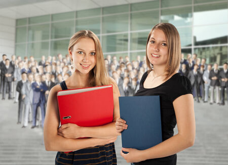 entrants: Two young employees are faced with a group of colleagues  Stock Photo