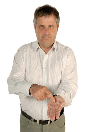to interpret: Man pointing to his palm