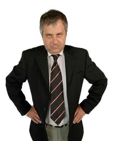 hands on hips: Senior business man looking strictly Stock Photo