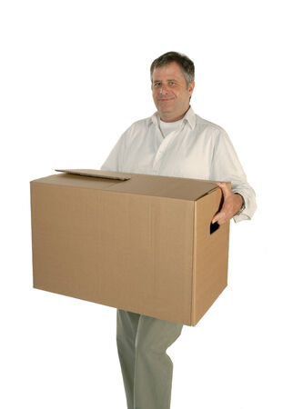 moving box: Mature man carries smiling a moving box