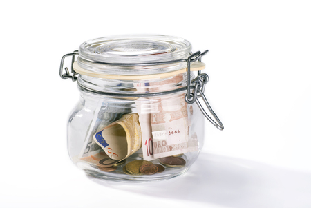 sparingly: Jar with savings isolated on white