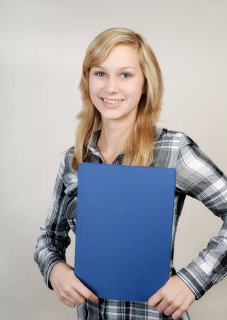16 17: Young pretty woman in business outfit with blue folder