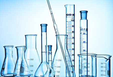 Flask, Measuring Cylinders, Glass Mug and pipette in laboratory