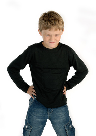 disobedient child: Angry little boy braces his hands on his hips
