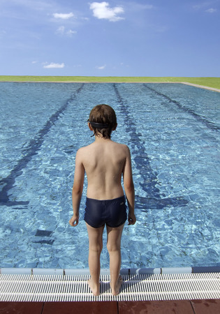 8 10 years: Boy at a large pool  Stock Photo