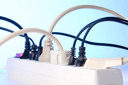 self indulgence: Multiple socket with plugs  All terminals are occupied  Stock Photo