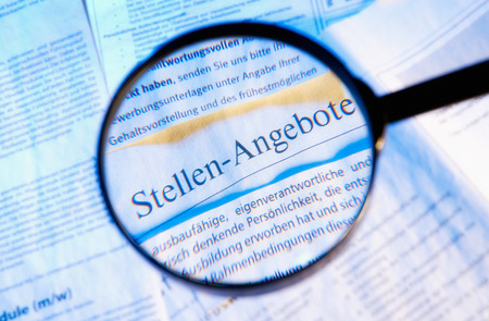 Magnifier and Vacancies and the word  Stellenangebote  Standard-Bild