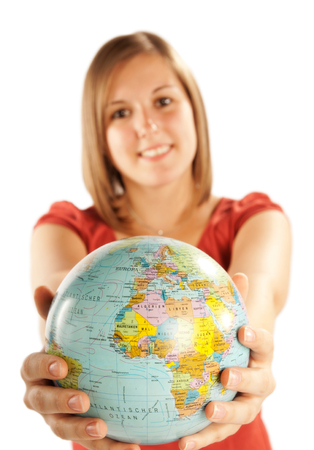 Young blonde woman with a globe in her hands  photo