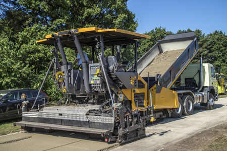 asphalt paving: Paver on road construction Stock Photo