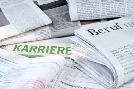 printed matter: Daily newspapers with job vacancies and the writing  Karriere