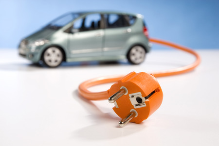 efficiently: Car, power cable and plug Stock Photo