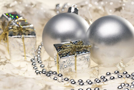 expectancy: Two silver Christmas baubles with additional Christmas decoration.