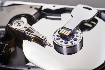 metal processing: Close up of a hard disk with USB stick