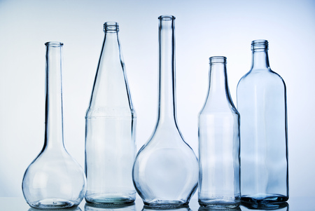 pureness: Five glass bottles in a row Stock Photo