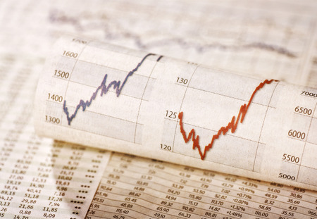 share prices: Diagrams with rising share prices and exchange rate tables Stock Photo