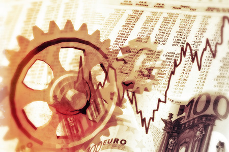 Gear wheels, rate tables, stock quotes and notes symbolize the interaction between the economy and stock market.