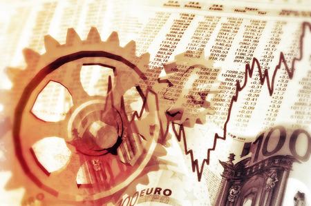Zahnräder, Drehtische, Börsenkurse und Notizen symbolisieren das Zusammenspiel zwischen Wirtschaft und Börse.