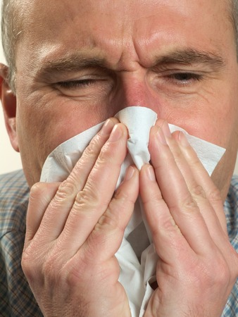 venal: Man blows his nose in a handkerchief