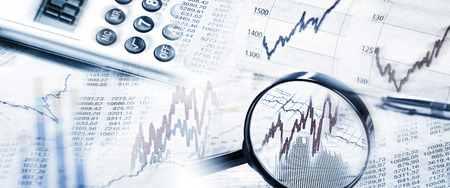 financial analysis: Stock quotes with magnifier and calculator
