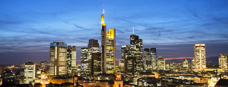 property management: Frankfurt skyline at night in Panorama format Stock Photo