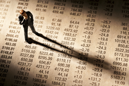 cogitate: Broker stands on stock price chart, and casts a long shadow.