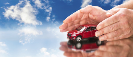 Car with hands and blue sky in background