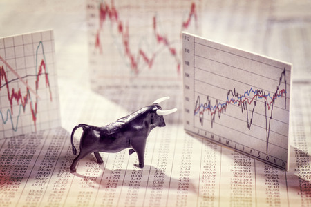 Figure of a bull with quote and charts Imagens - 51168731