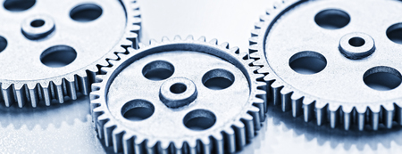 Two large and a small gear wheel Which overlap