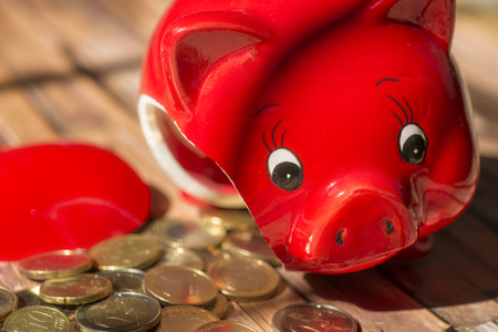 Broken piggy bank with many coins Stock Photo