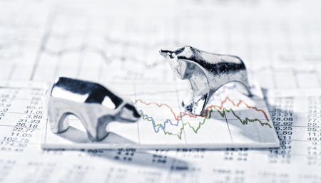 Bull and Bear standing on a graphic with market prices