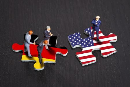 protectionism: Puzzle pieces with the flags of Germany and the USA
