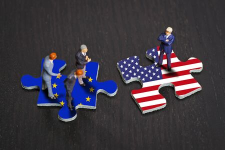 protectionism: Puzzle pieces with the flags of Europe and the USA Stock Photo