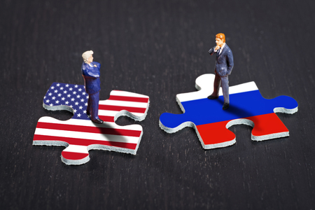 protectionism: Puzzle pieces with the flags of the USA and Russia