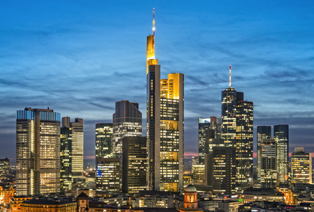 Skyline of Frankfurt with illuminated skyscrapers