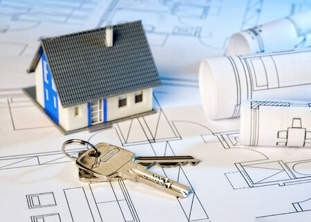 House and two keys on construction plans
