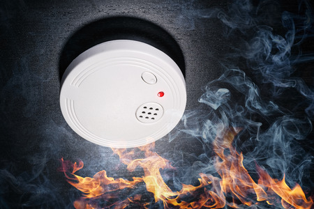 Smoke detector with flames and smoke