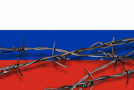 Barbed wire with shadow in front of a Russian flag Stock Photo