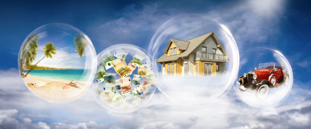 Soap bubbles with beach scene, banknotes, house and car