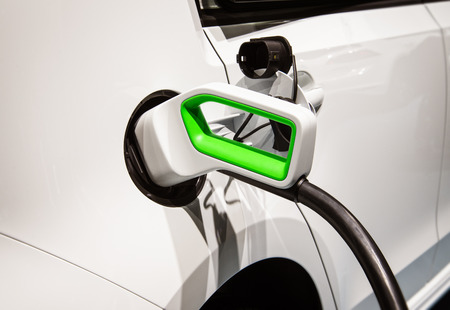 Detail of an electric car with green plug Reklamní fotografie